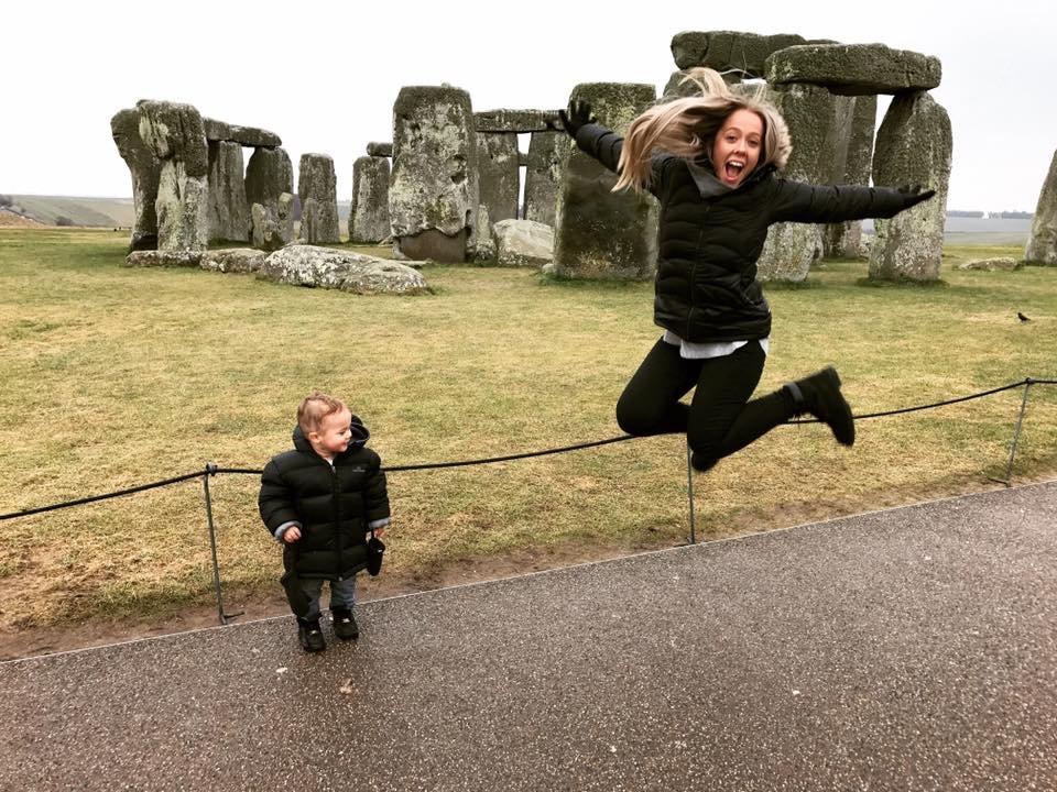Stonehenge UK, Erin jumping and Hamish just looking cute