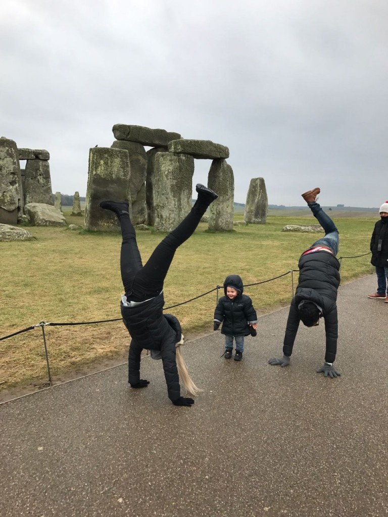 Stonehenge UK, family handstand with Hamish looking cute