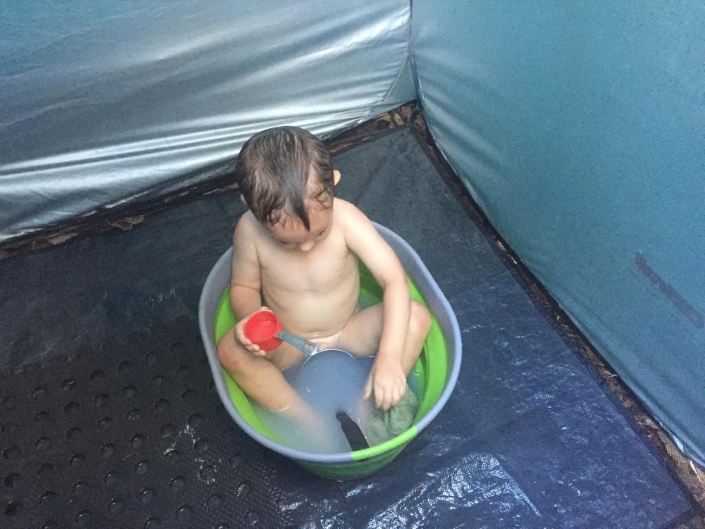 Hamish enjoying his first bush bath