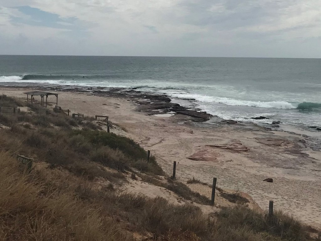 Surfers at Red Bluff Beach, Kalbarri WA
