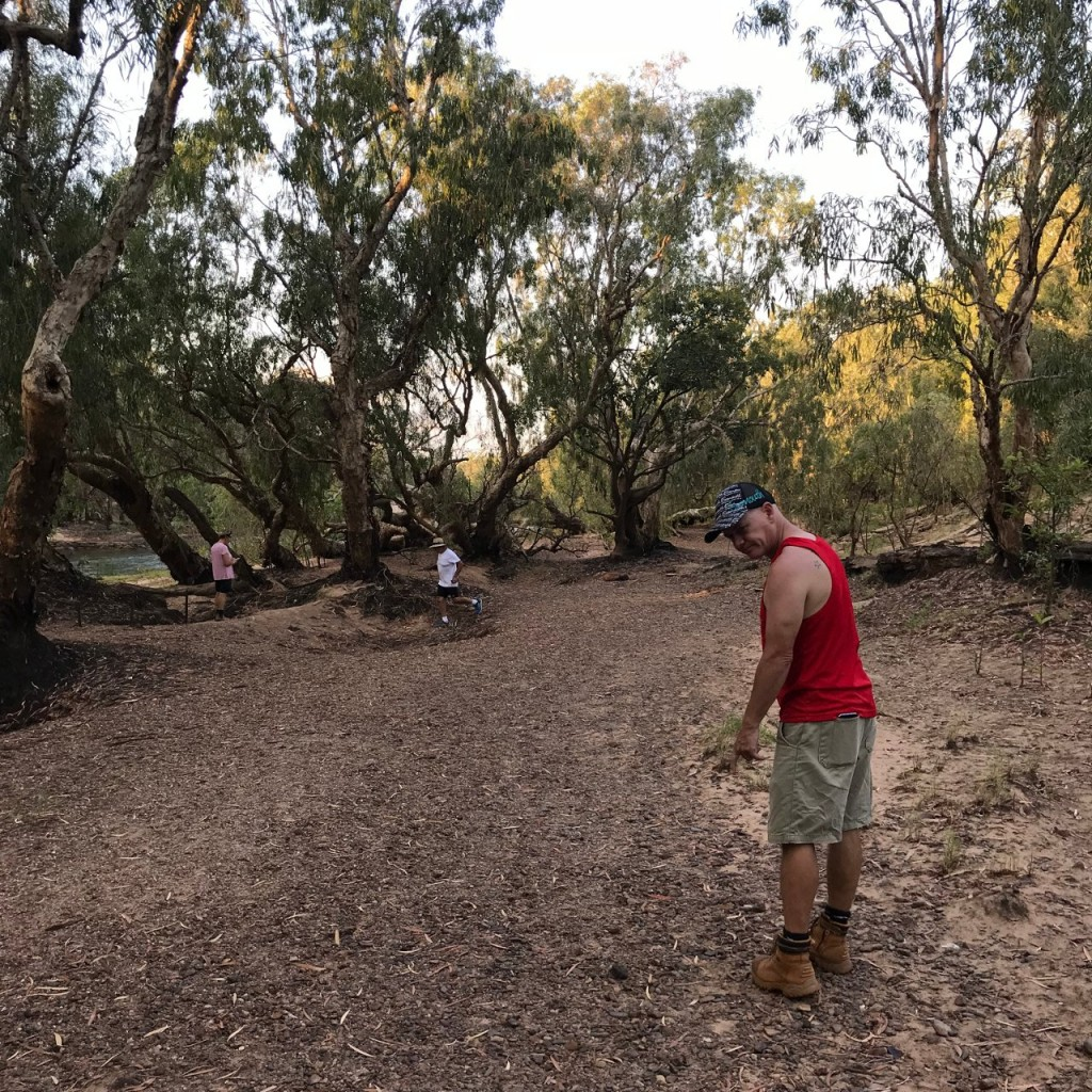 Col looking for Antlion Cones in the sand, Manbulloo Station River Walk NT